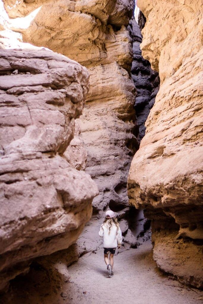 girl hiking in ladder canyon - one of the best hikes around palm springs