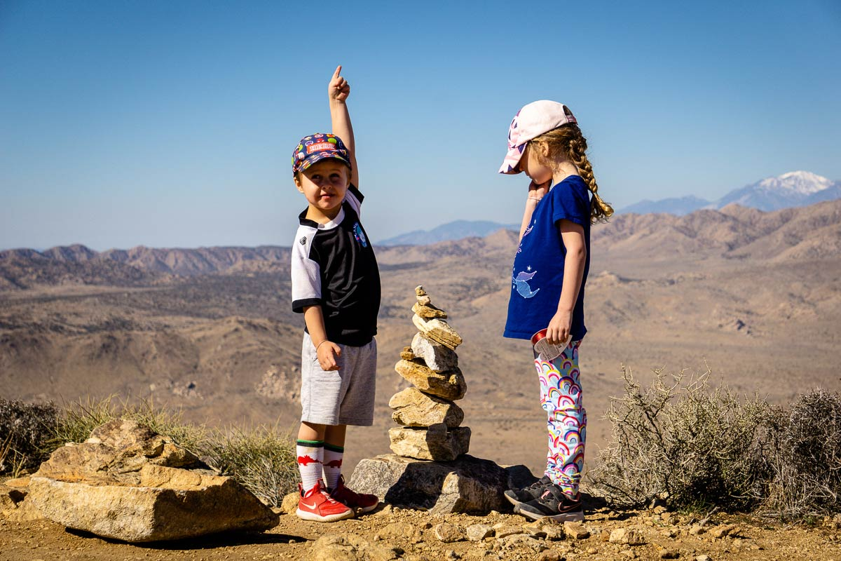image of two kids at the top of Ryan Mountain in Joshua Tree NP
