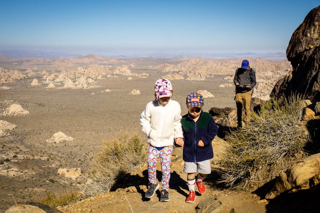 image of family hiking up Ryan Mountain, one of the best hikes in Joshua Tree National Park