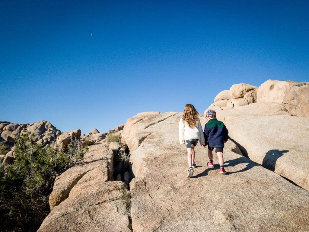 image of two kids climbing rocks along Split Rock Trail in Joshua Tree National Park