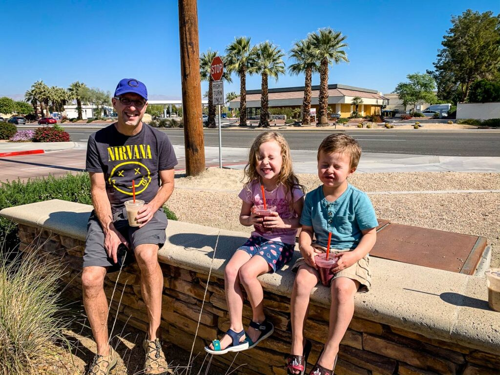 Image of father and two kids drinking smoothies in Palm Springs