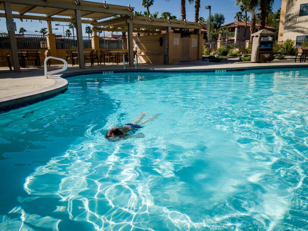 image of girl swimming in pool at hotel in Palm Springs
