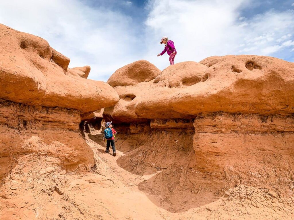 image of two kids playing at goblin state valley park in utah