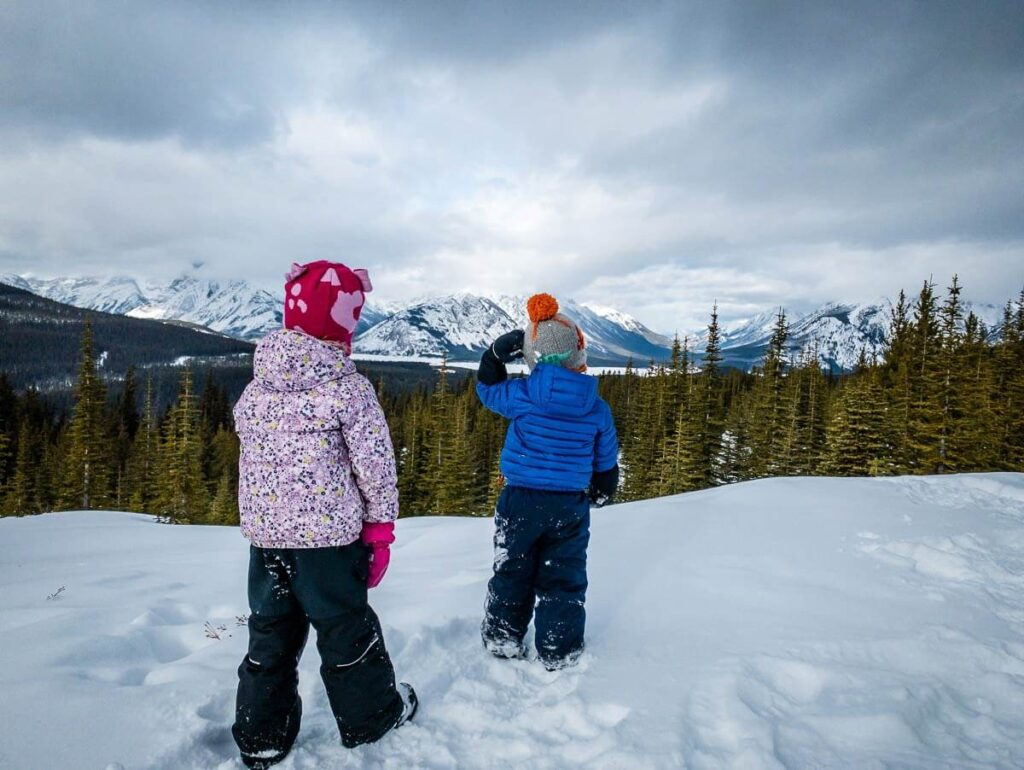 image to two kids winter hiking