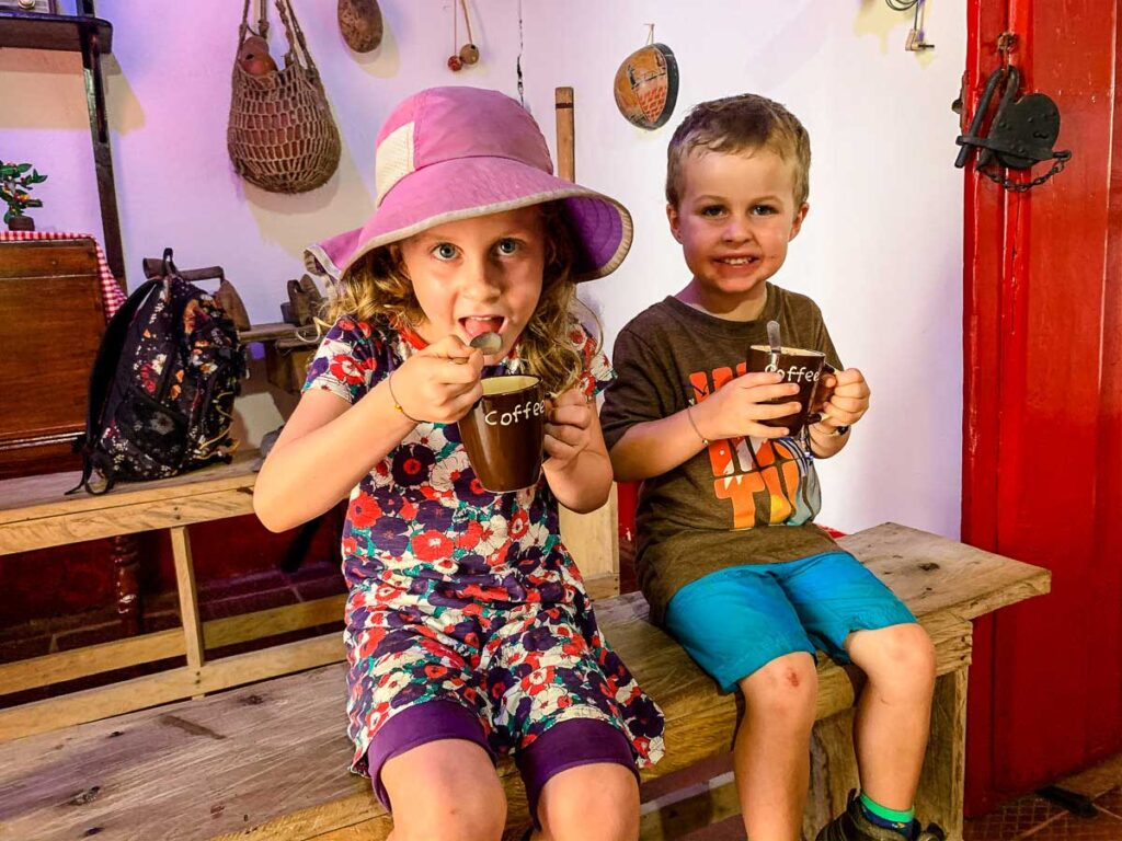 Kids enjoy a hot chocolate at the La Calendria cacao farm in Minca, Colombia