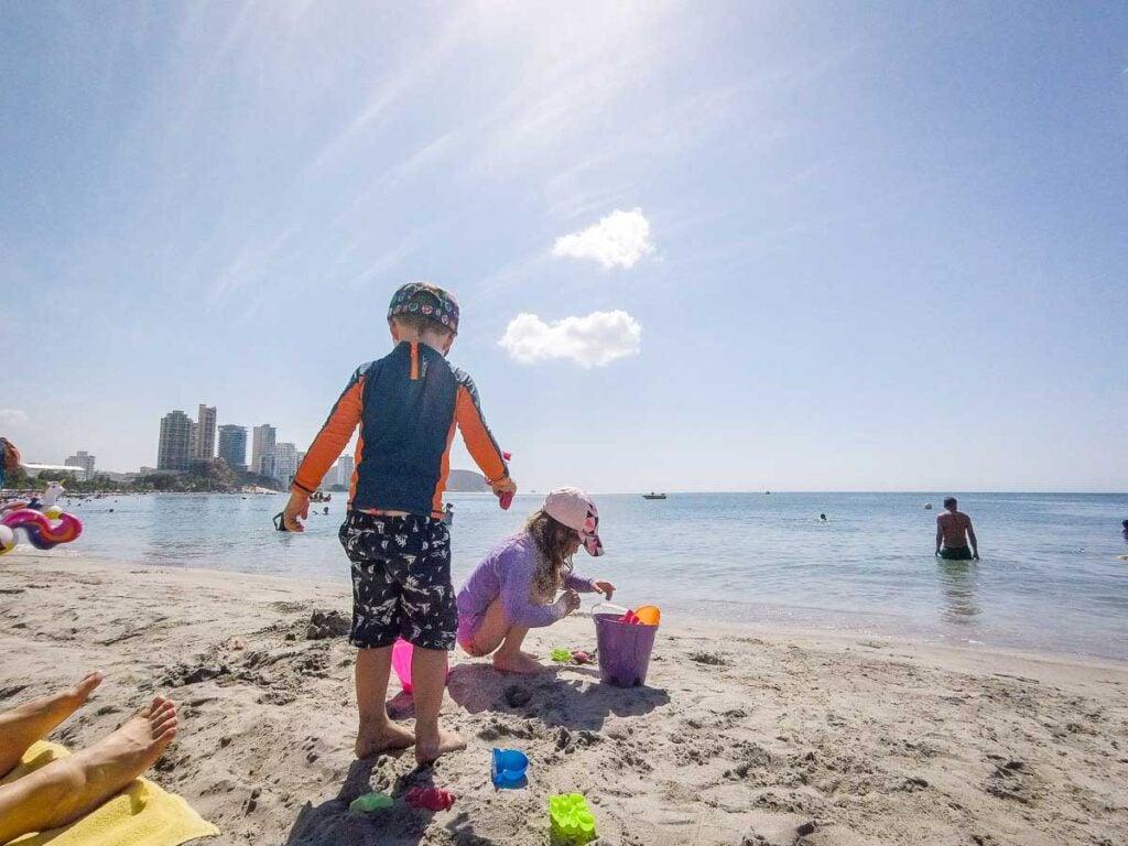 kids playing in the sand at Playa el Rodadero, near Santa Marta, Colombia