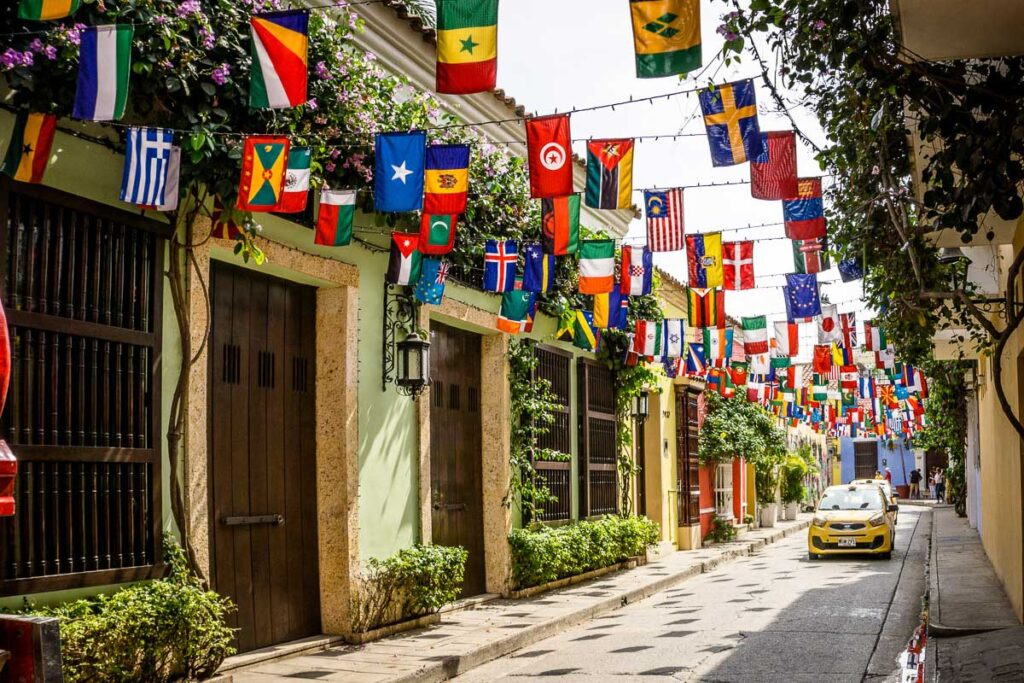 Flags of the world fly above the streets in Getsemani, Cartagena, Colombia