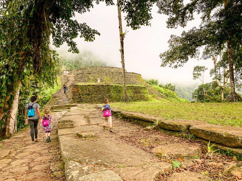 A family enjoys exploring the Ciudad Perdida archaeological site