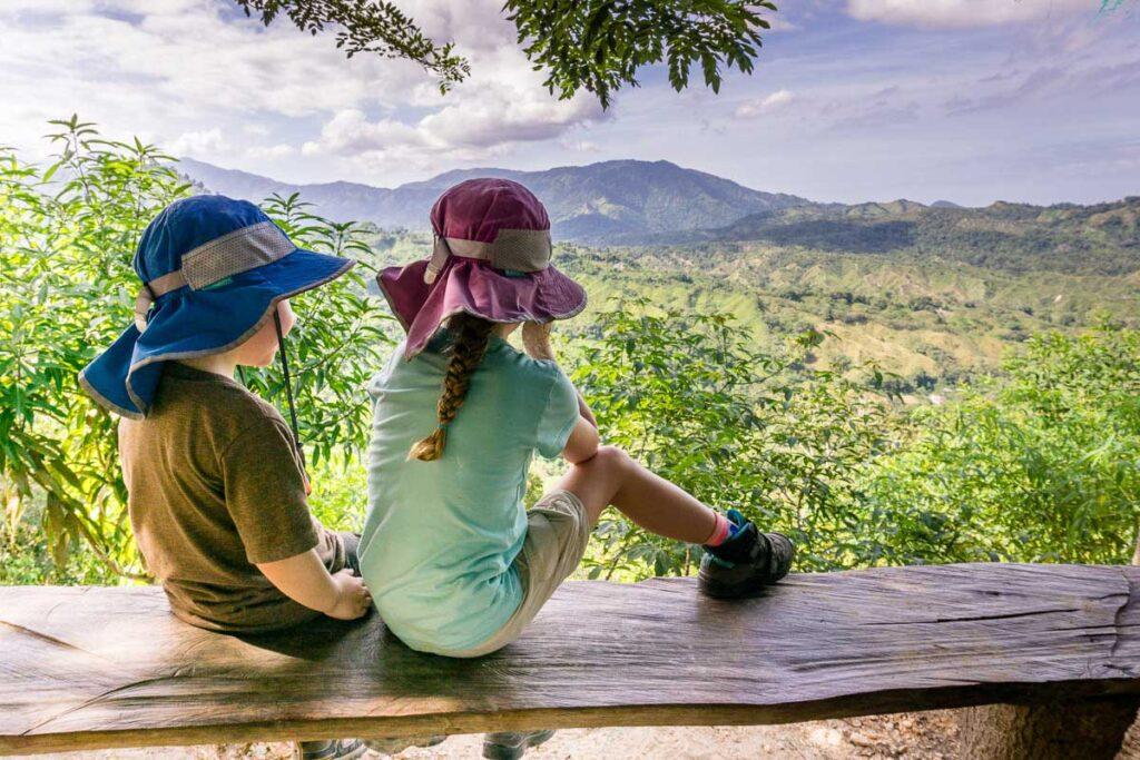 Kids enjoying a spectacular view of the Sierra Nevada mountains on the Ciudad Perdida trek