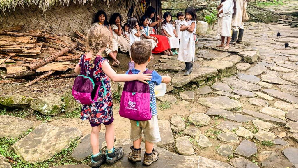 Canadian kids meeting indiginous kids while trekking Ciudad Perdida