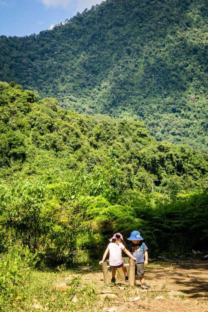 Two kids enjoy a break on the way back to El Mamey after sucesfully hiking to the Lost City Colombia
