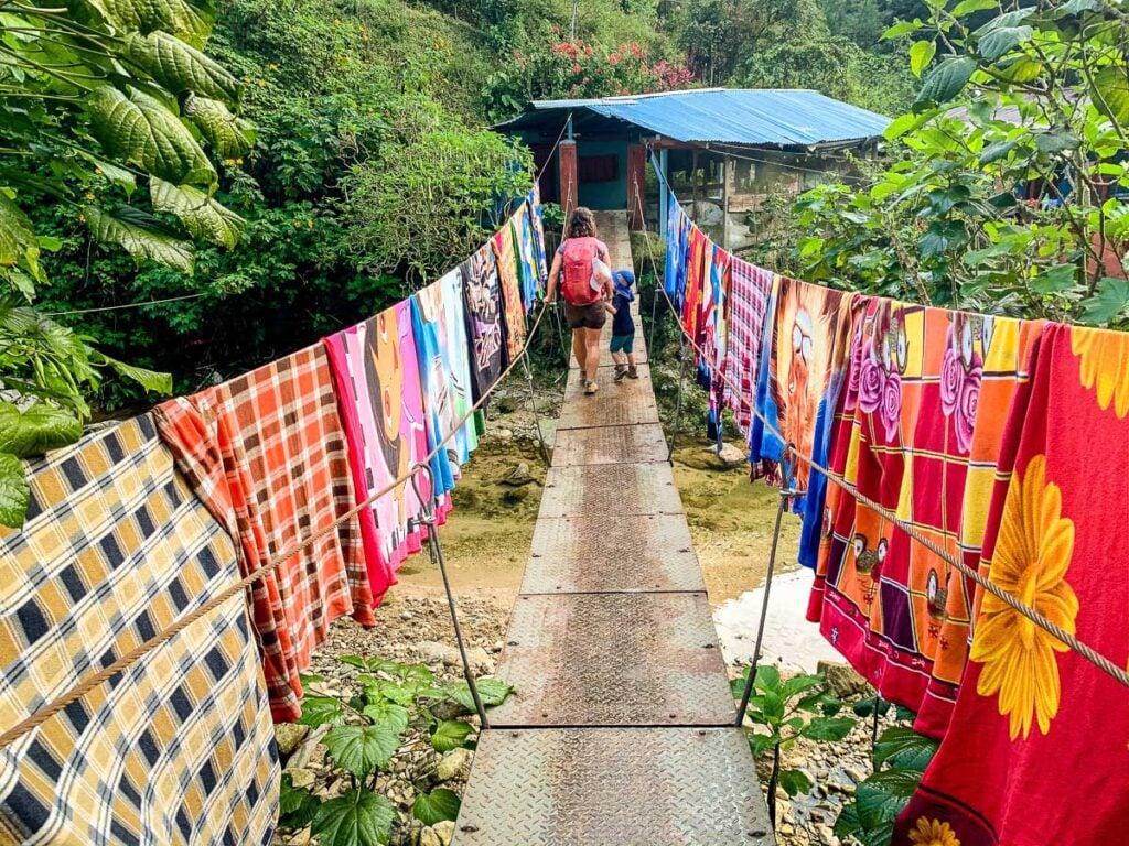colorful blankets line a bridge on the Ciudad Perdida trek