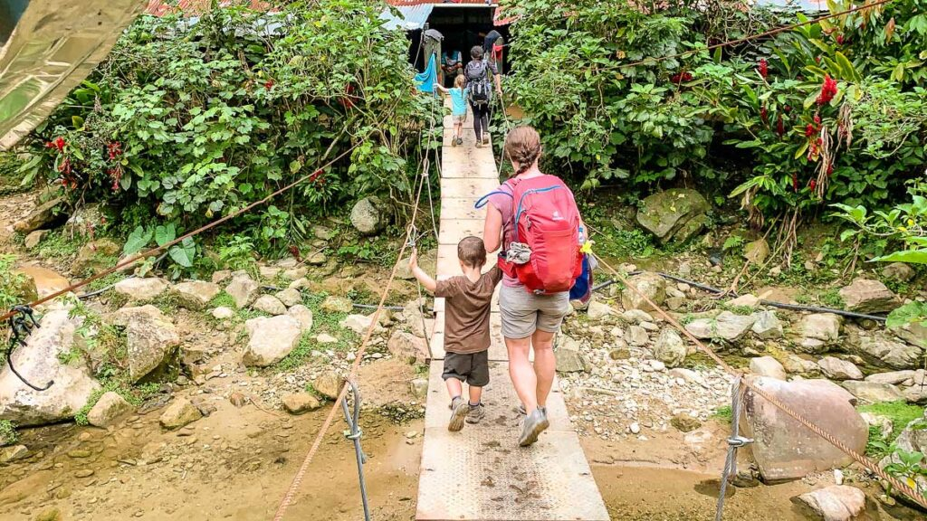 Using a bridge to cross a river on the Lost City trail