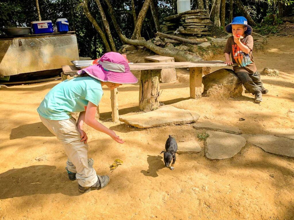 Two kids take a break while hiking to Ciudad Perdida
