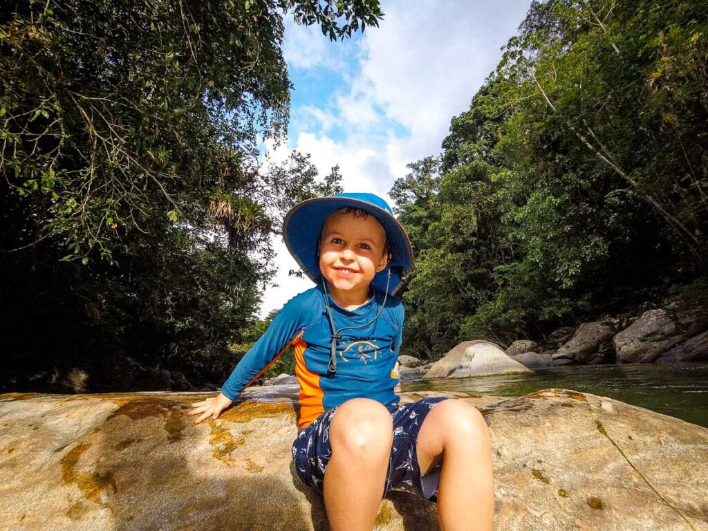 A boy enjoys swimming in the river at Camp 2 while trekking to la Ciudad Perdida