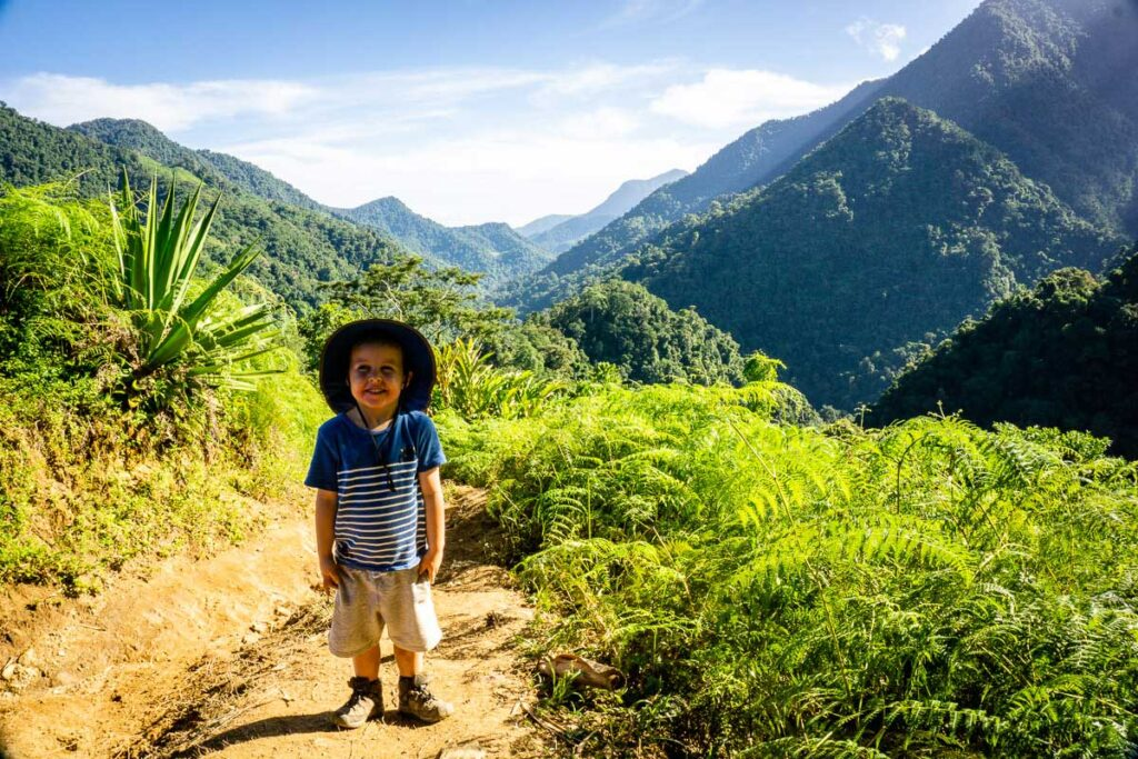 A 4-year old boy is all smiles while trekking to the Lost City in Colombia