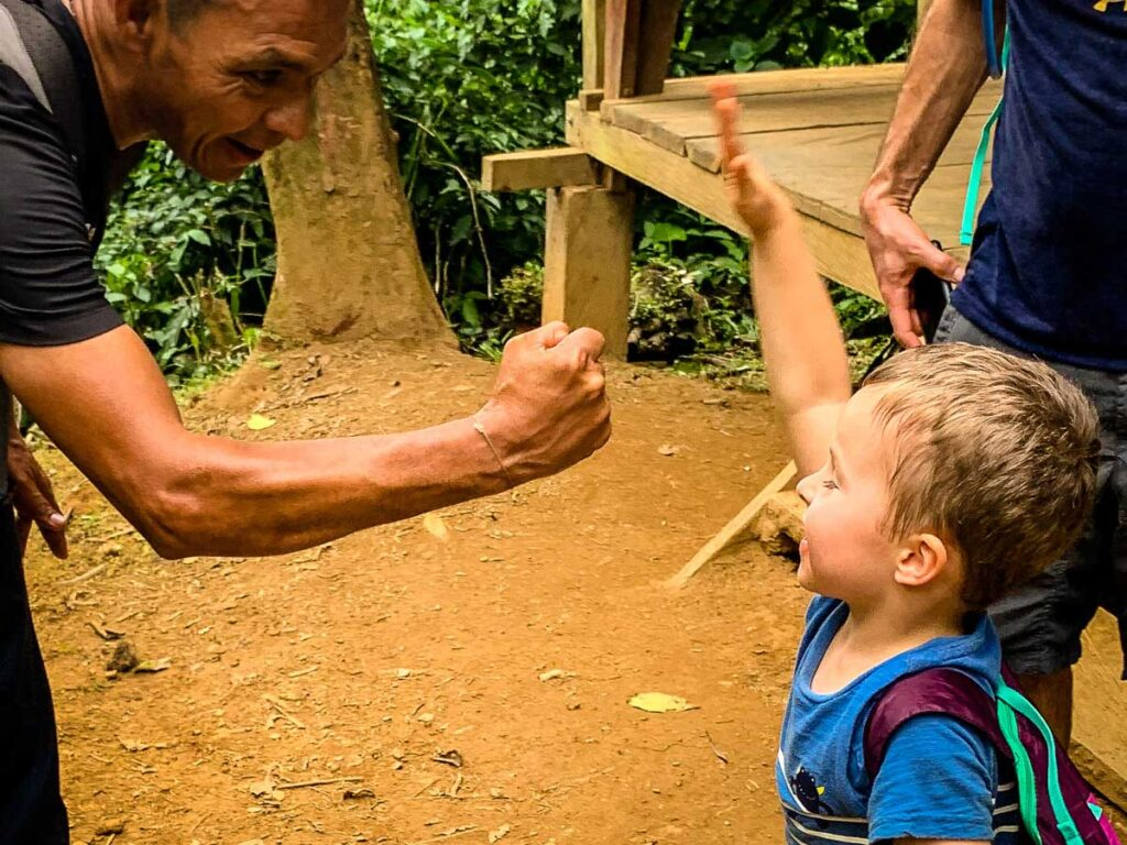 Our Lost City guide fist bumps our 4-year old son after a good day of hiking in Colombia