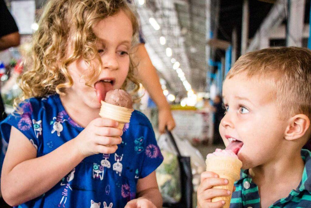kids enjoying ice cream at a Thai market