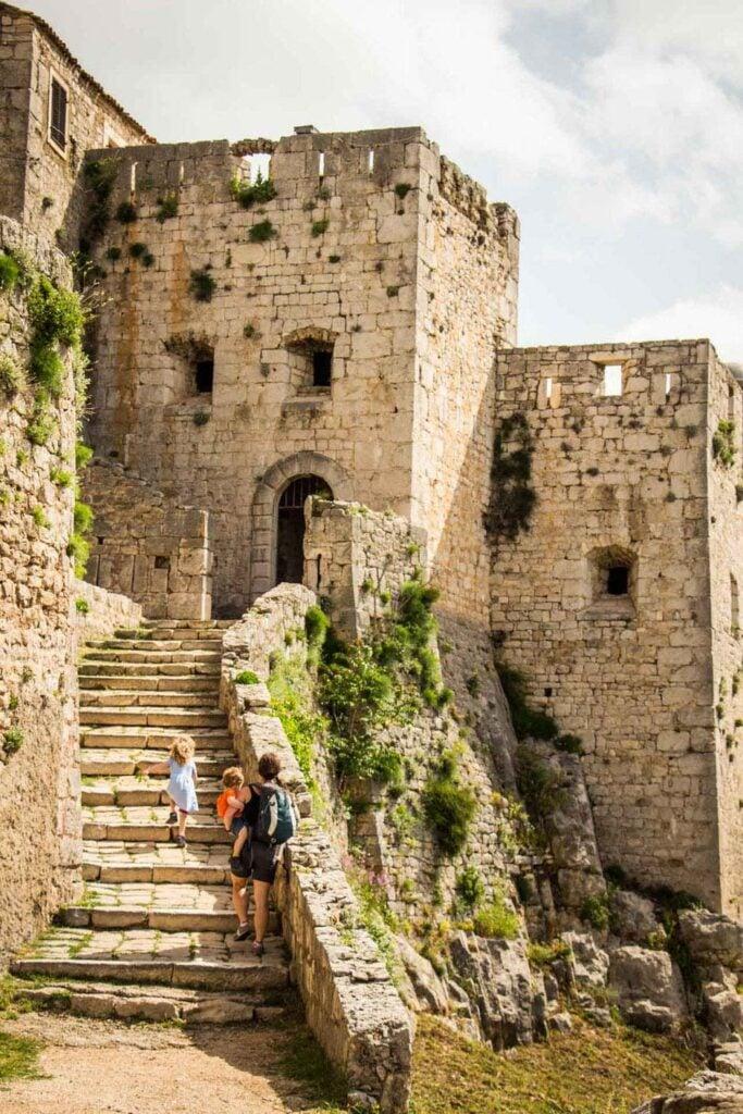 A family visits Klis Fortress, Croatia