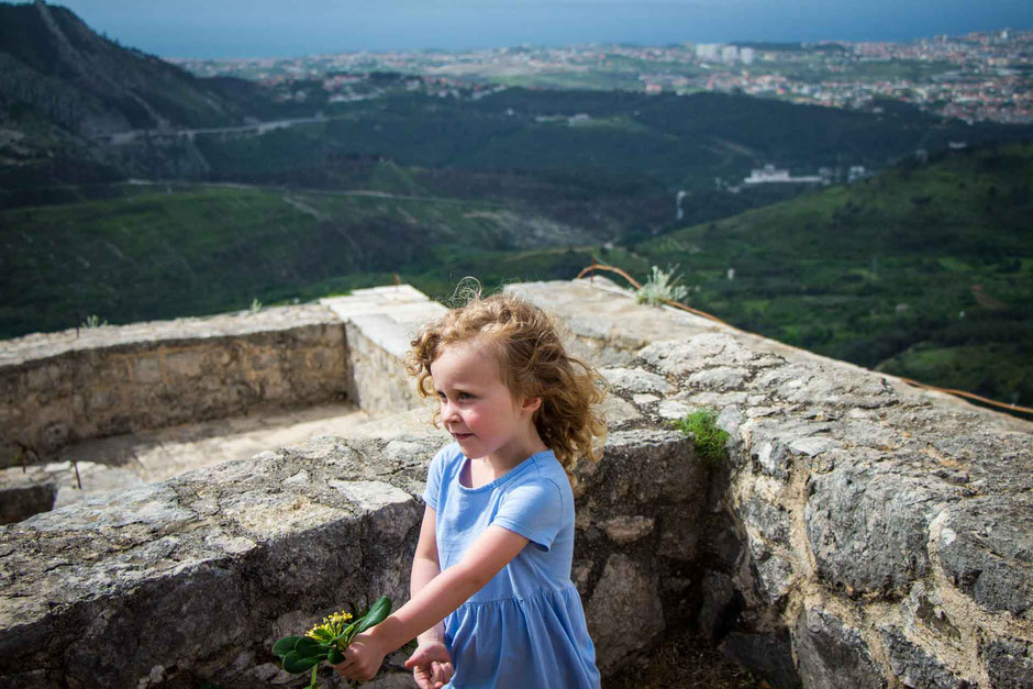 A girl enjoying a visit to the Klis Fortress in Split, Croatia