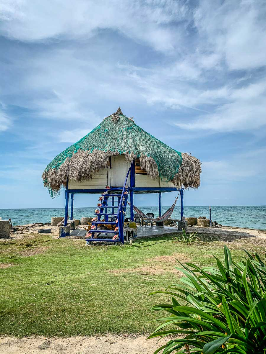 An oceanfront thatched roof hut at the Dahlandia resort on Isla Mucura, Colombia