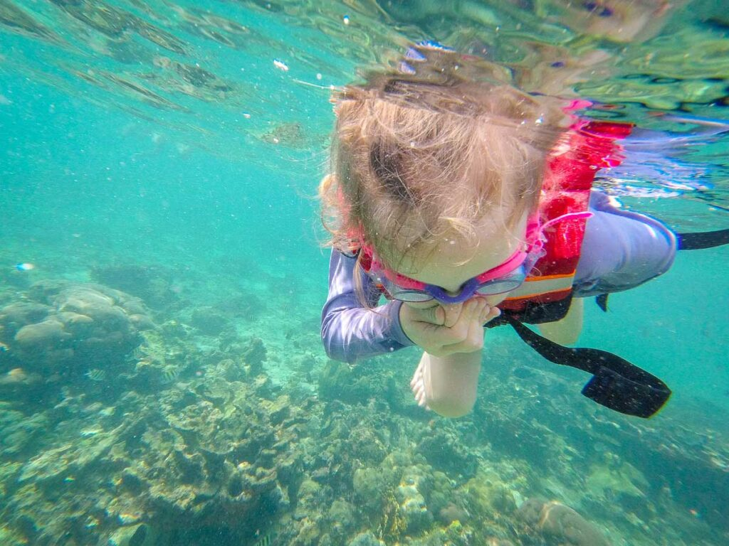 Learning how to snorkel in the Caribbean Sea between Isla Mucura and Isla Tinpan