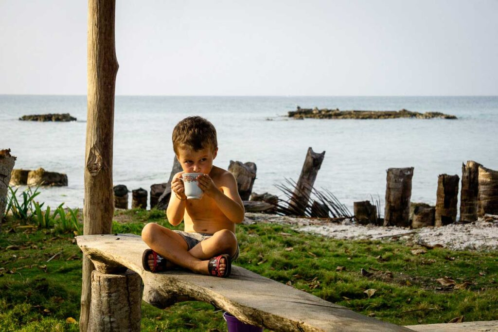 A boy enjoys relaxing at Dahlandia, Isla Mucura