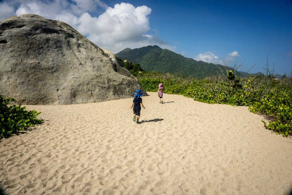 The kids enjoyed running in the sand while hiking to Cabo San Juan, Tayrona National Park, colombia