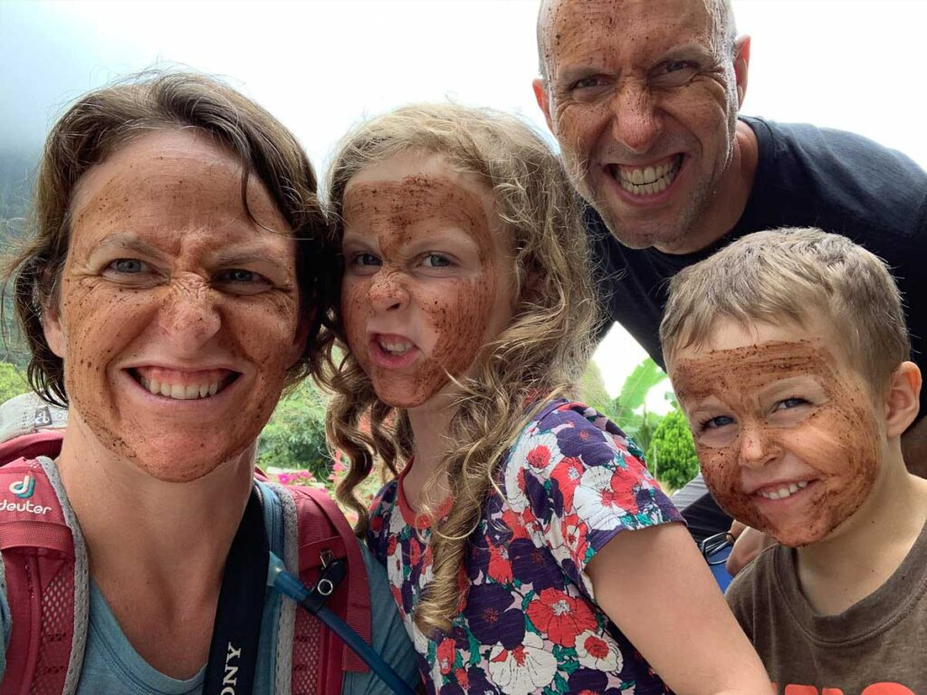 The Family Can Travel gang shows off their cacao face masks in Minca, Colombia