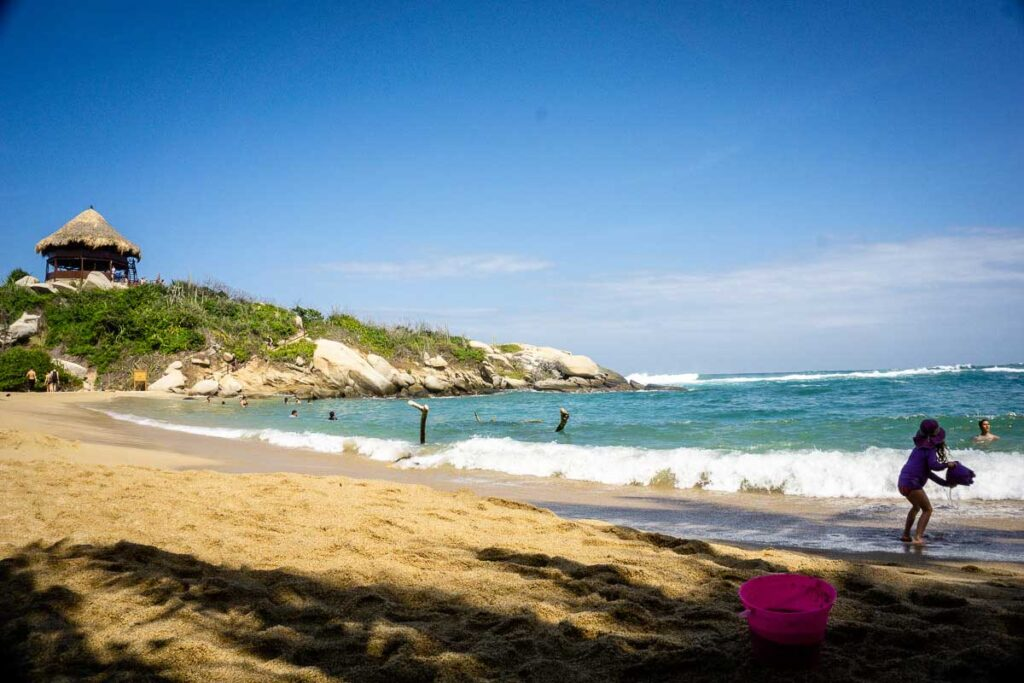 Kids playing at the Cabo San Juan beach in Tayrona Colombia