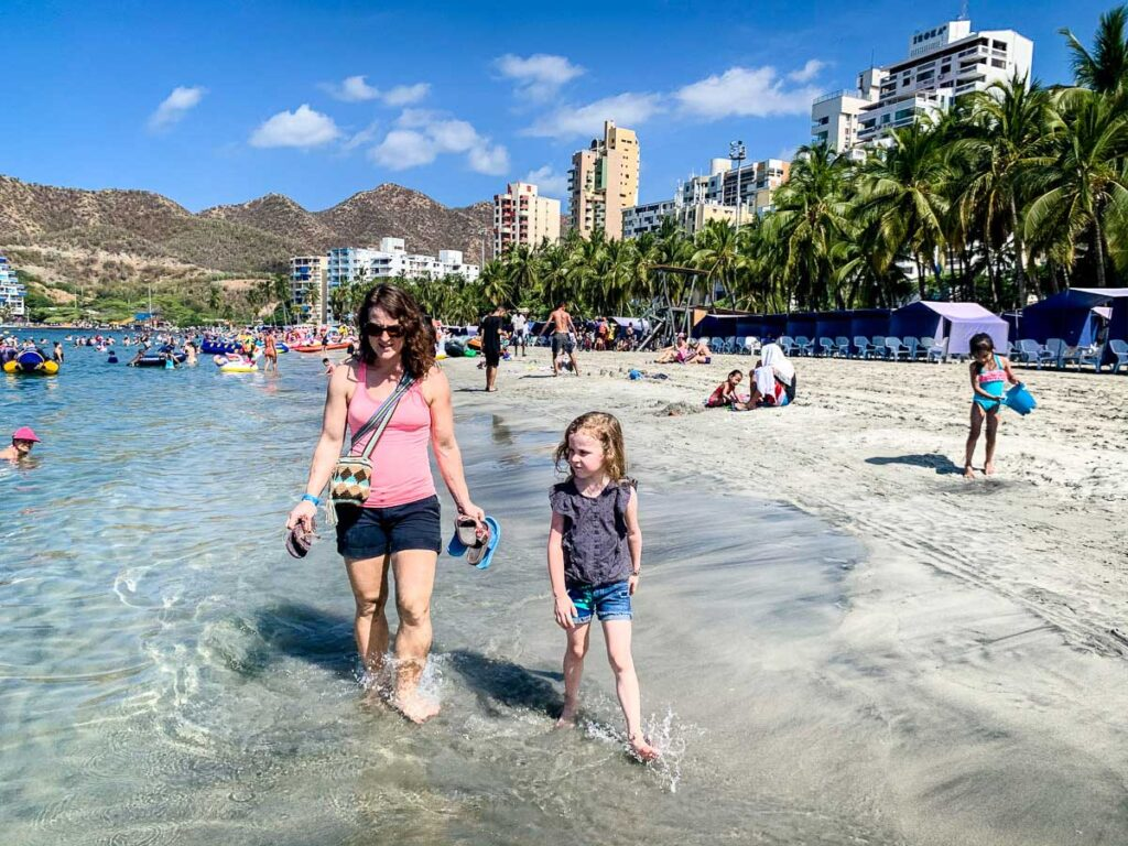 A family walk in the surf at Rodadero Beach Colombia
