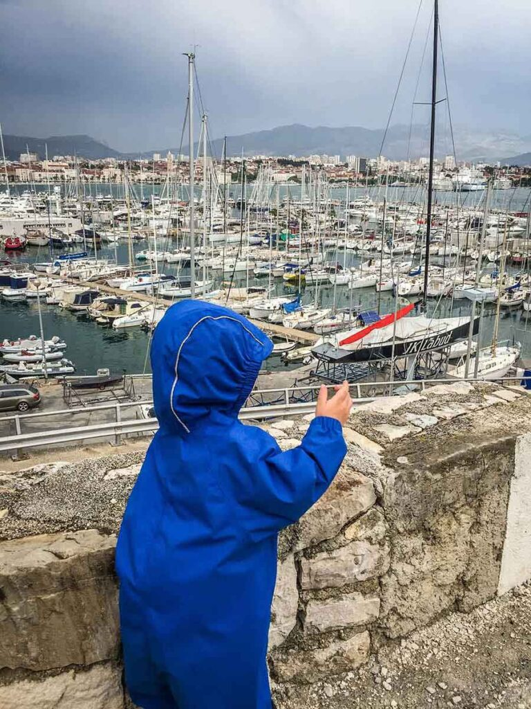 Walking past marina in Split Croatia with a toddler
