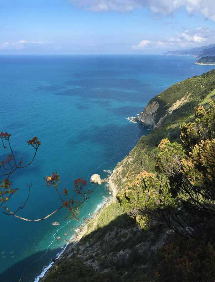 The beautiful blue waters of the Ligurian Sea as seen from the Monterosso to Levano trail in Cinque Terre, Italy