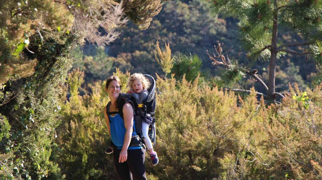 A mother and toddler enjoy a beautiful forest on the Corniglia to Manarola hike in Cinque Terre