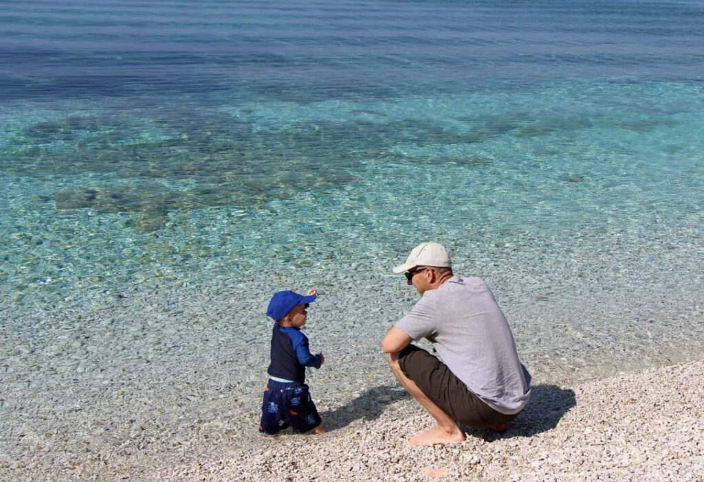 Toddlers love playing with rocks at the Elba beaches