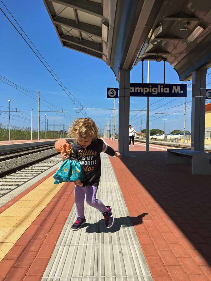 Taking the train in Italy with kids was a lot of fun - goofing around at the Campiglia Marittima train station