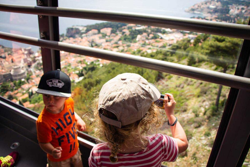 taking the cable car up Mount Srd in Dubrovnik with toddlers