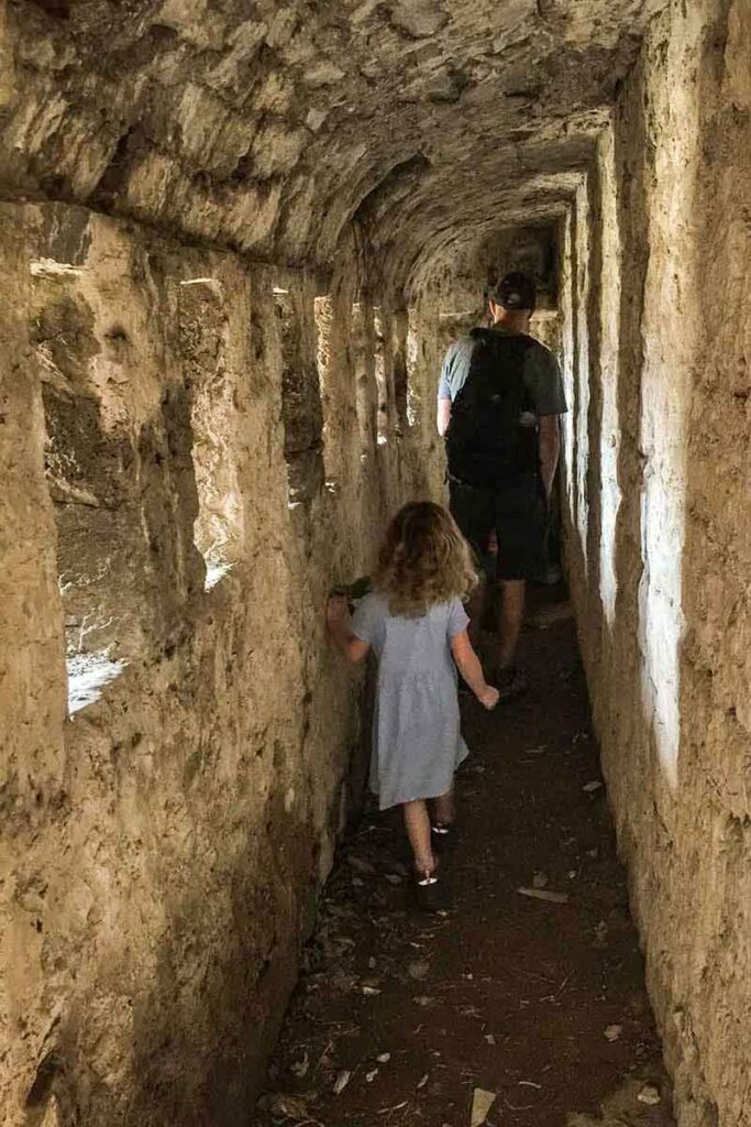 Exploring tunnels at Klis Fortress in Split with kids