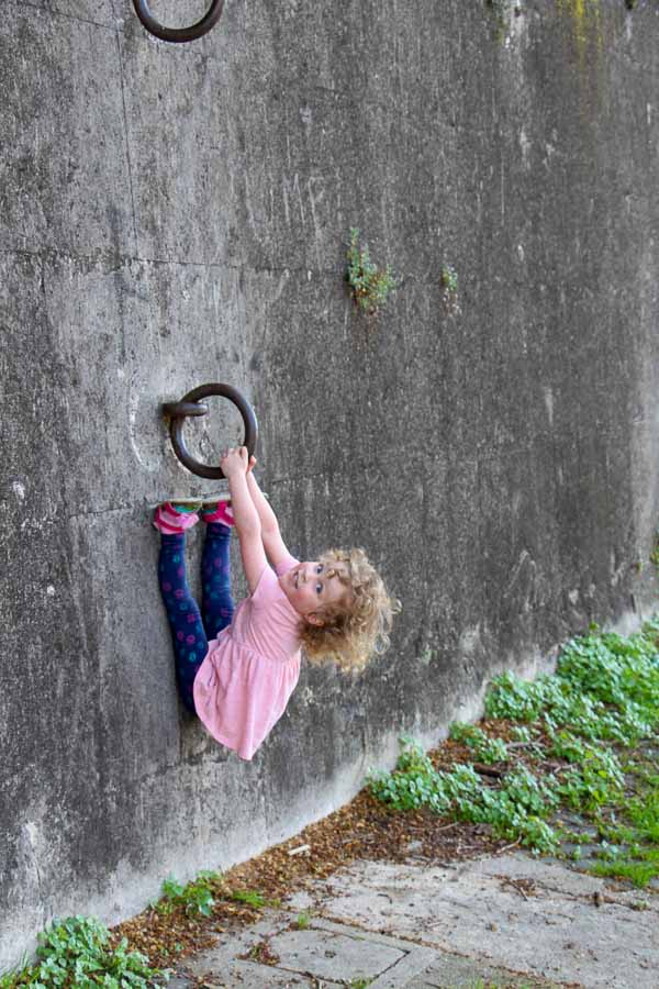 Kids in Rome can have fun anywhere - such as this steel ring along the Tiber River walkway