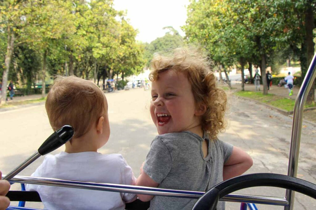 Riding a four seat Surrey bike in Villa Borghese Gardens was a super fun activity for kids in Rome