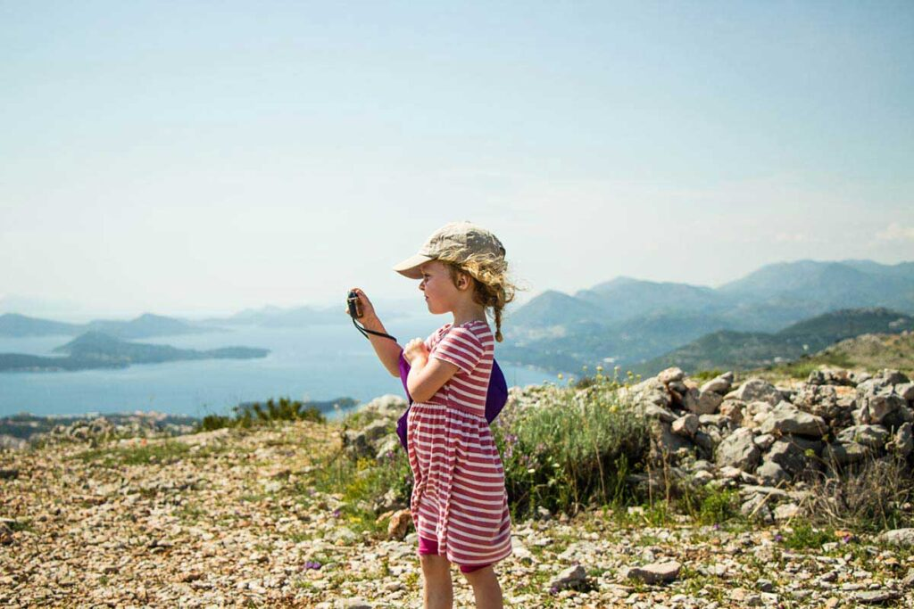 Taking pictures at the top of Mount Srd - What to do in Dubrovnik with kids