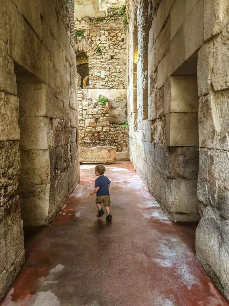 visiting the Palace substructures on a rainy day in Split with a toddler