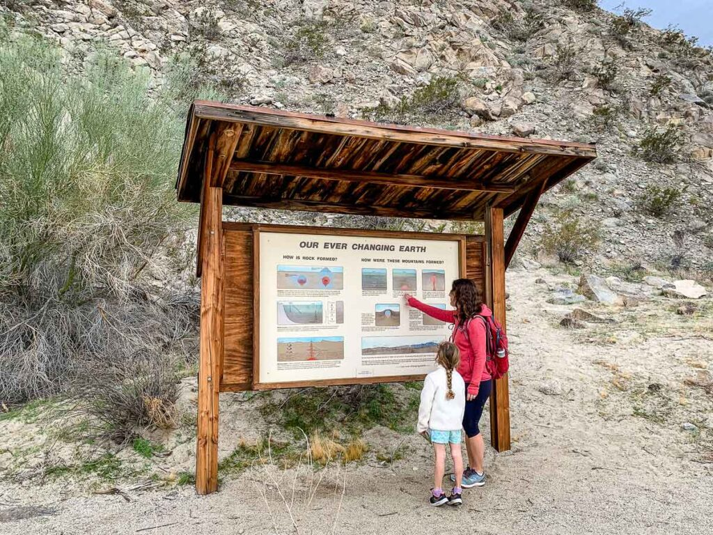 A mother teaches her daughter about rock formation while hiking at the Living Desert in Palm Desert