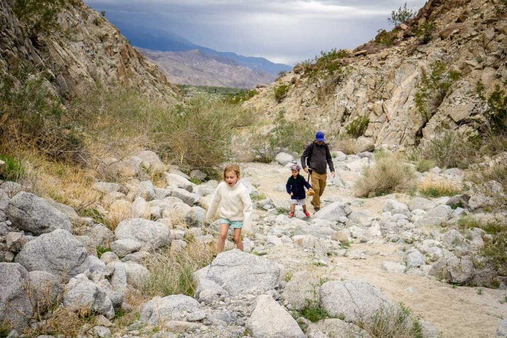 Kids enjoying playing Hot Lava while hiking in Palm Desert