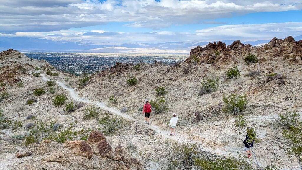 A family enjoys the Living Desert hiking trails in Palm Desert