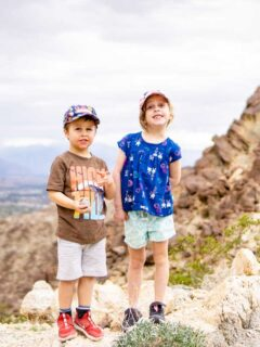 Two kids having fun while hiking the Wilderness Loop trail on Eisenhower Mountain in Palm Desert, CA