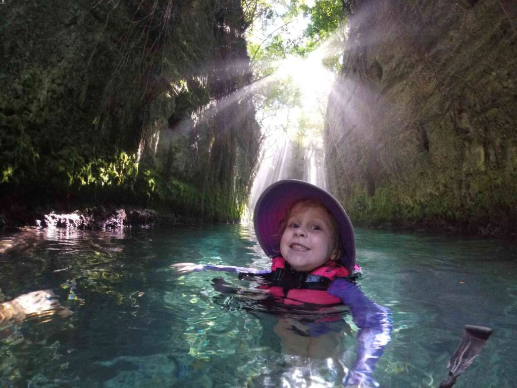 Swimming the underground river at Xcaret with kids