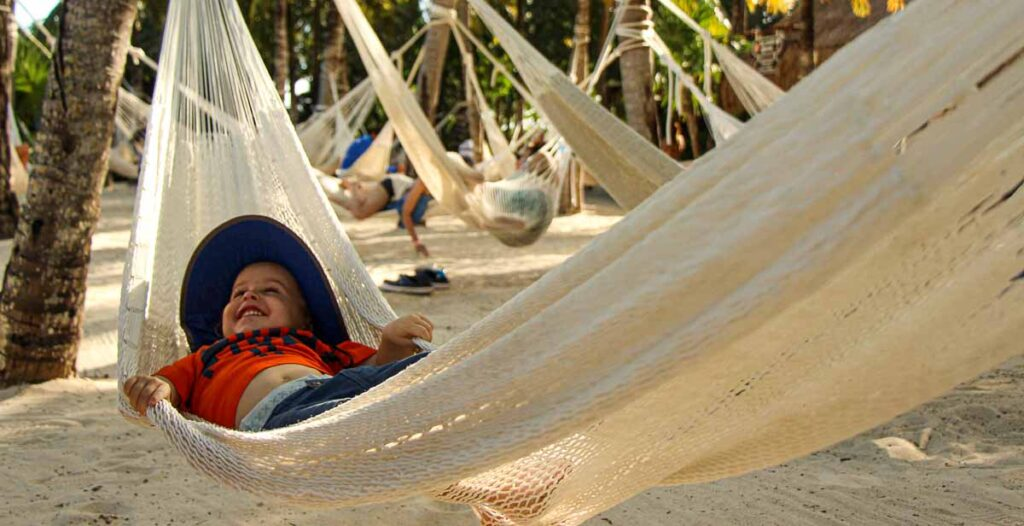 After going crazy at Xel-Ha Children's World, give your toddler a chance to rest in the nearby hammocks