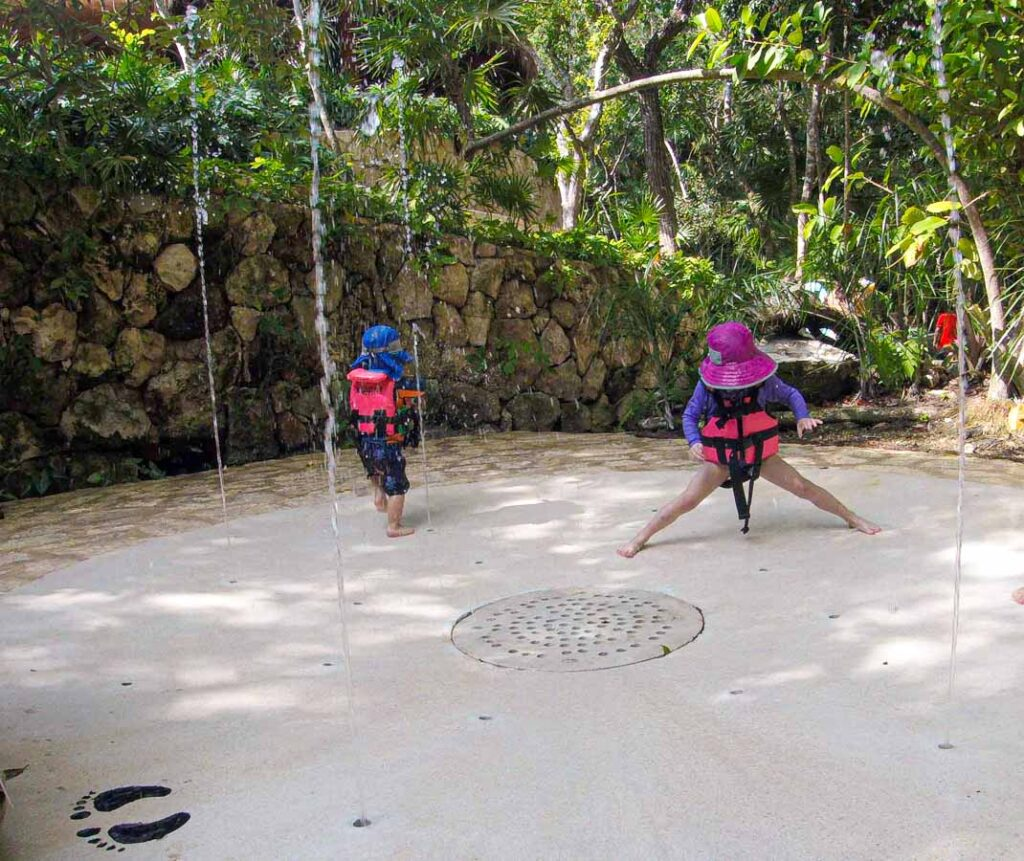 Kids play at the splash park at Children's World Xcaret