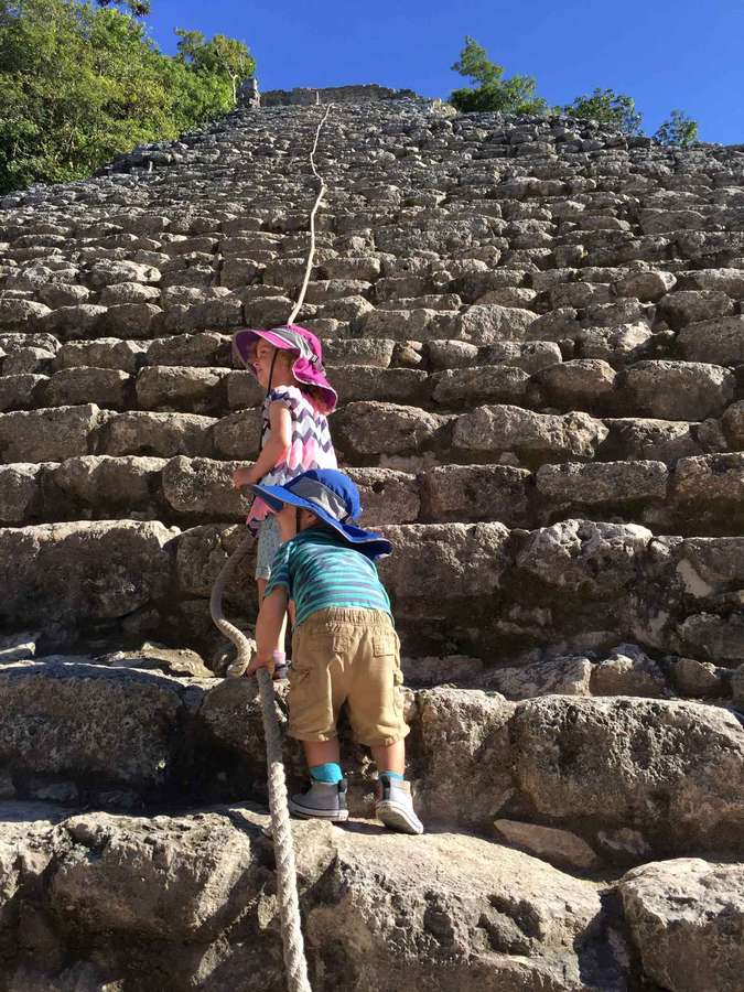 Climbing the Nohoch Mol pyramid at Coba with kids